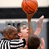 Beck Diefenbach - bdiefenbach@daily-chronicle.com<br /> <br /> DeKalb's Jordan Threloff (back) prepares to jump against Kaneland's Dave Dudzinski during the first quarter of the IHSA Class 3A Regional championship game at Kaneland High School in Maple Park, Ill., on Friday March 3, 2010.