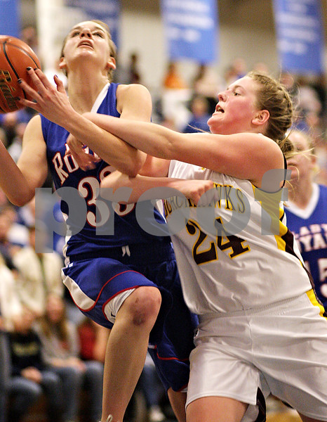 Beck Diefenbach  -  bdiefenbach@daily-chronicle.com<br /> <br /> Hinckley-Big Rock's Tess Godhardt is fouled by Stockton's Haley Magee (24, right) during the third quarter of the IHSA Class 1A Super Sectional championship game at Judson University in Elgin, Ill., on Monday Feb. 22, 2010.
