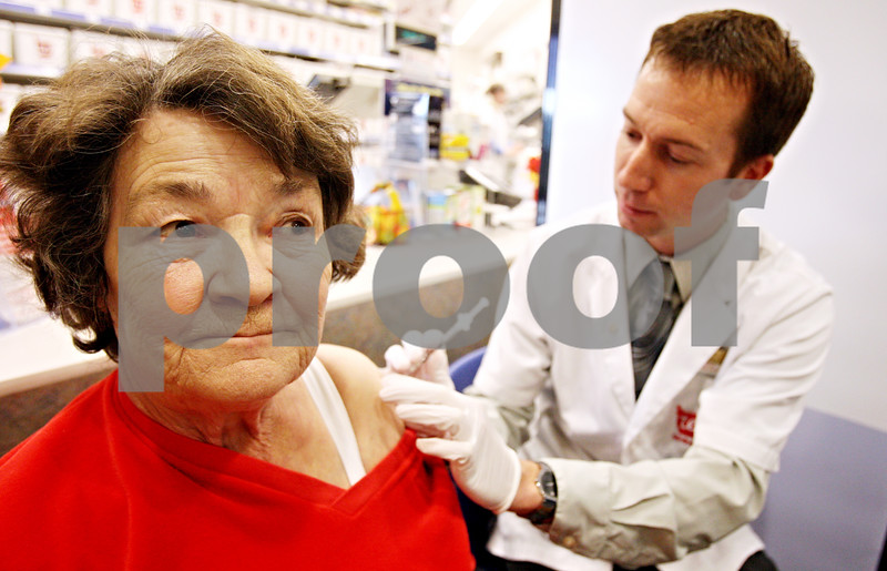 Rob Winner – rwinner@daily-chronicle.com<br /> <br /> Linda Hoadley, of Piggott, Arkansas, receives a flu shot from pharmacist Josh Weber at the Walgreens in Sycamore on Monday afternoon.