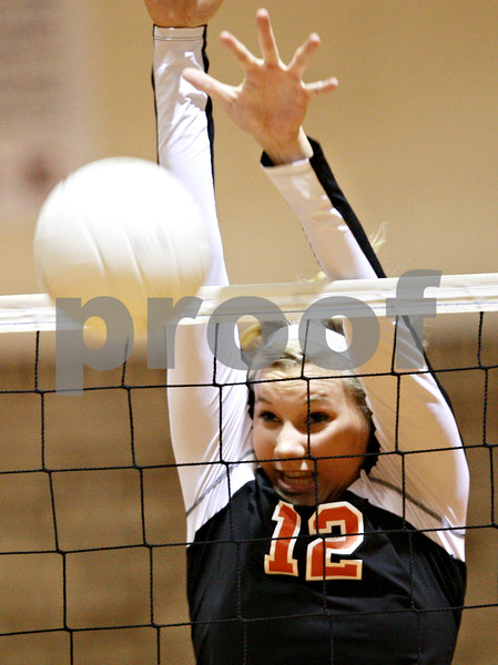 Beck Diefenbach – bdiefenbach@daily-chronicle.com<br /> <br /> DeKalb's Courtney Thomas (12) blocks a shot by Morris during the second game at DeKalb High School in DeKalb, Ill., on Tuesday Sept. 28, 2010. DeKalb defeated Morris 2 games to 0.
