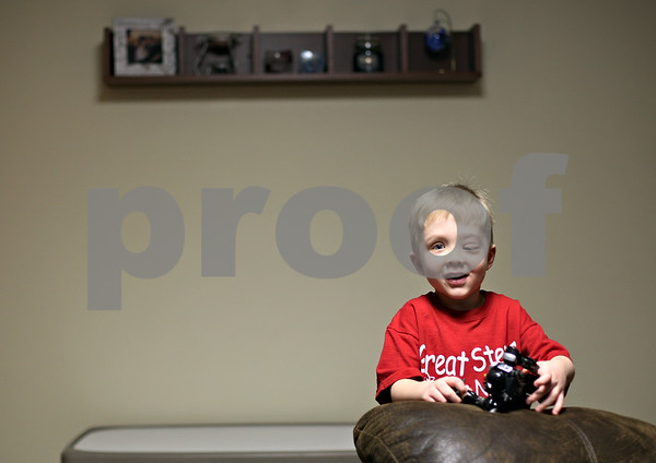 Beck Diefenbach  -  bdiefenbach@daily-chronicle.com<br /> <br /> Tyler Neppel, 4, holds one of his toys in his family's Sycamore home on Friday March 5, 2010. Tyler is living with Neurofibromatosis which causes tumors to grow around his eye and his shin.