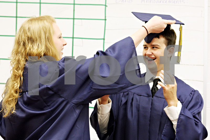 Rob Winner – rwinner@daily-chronicle.com<br /> <br /> Brittany Lutz helps fellow Hiawatha graduating senior Quentin Haluta with his hat before the start of their graduation ceremony on Friday May 28, 2010 in Kirkland, Ill.