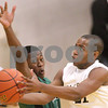 Kyle Bursaw – kbursaw@daily-chronicle.com<br /> <br /> Sycamore's Rashaud Bomar shoots as Catamount's Jason Williams defends. The Sycamore Spartans defeated the Gary Comer College Prep Catamounts  51-48 during the Leland G. Strombom Tournament on Friday, Nov. 26, 2010