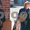 Kyle Bursaw – kbursaw@daily-chronicle.com<br /> <br /> Cub Scout Pack 140 members, from left, Matthew Reuscher, Robby McCarthy and Jordan Fleming carry a load of non-perishables from behind St. Mary's Church in Sycamore. <br /> <br /> Saturday, Nov. 27, 2010.