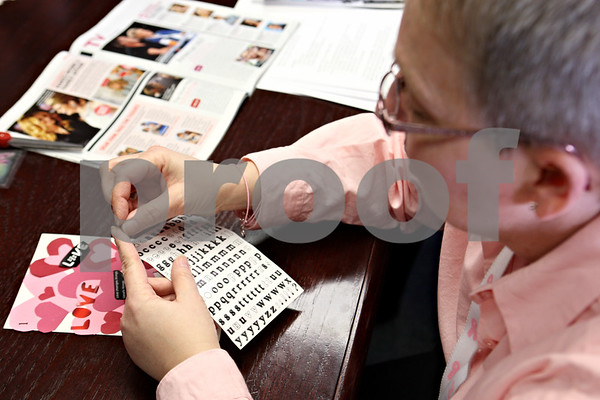 Rob Winner – rwinner@daily-chronicle.com<br /> Tammy Greene, of DeKalb, adds letters to a collage that she worked on during the Healing Expressions class at the Kishwaukee Cancer Care Center in DeKalb, Ill. on Tuesday March 2, 2010.
