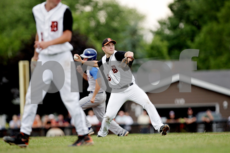 Rob Winner – rwinner@daily-chronicle.com<br /> <br /> After fielding a ground ball, Dekalb third baseman Ben Dallesasse fires to first to end the first inning during the IHSA Class 3A DeKalb Sectional championship game on Saturday June 5, 2010 in Dekalb, Ill. DeKalb went on to defeat Marmion Academy, 6-5.