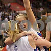 Beck Diefenbach - bdiefenbach@daily-chronicle.com<br /> <br /> Hinckley-Big Rock's Maxzine Rossler (top) embraces teammate Jes Meyer after defeating Ridgewood to win the IHSA Class 1A semifinal game at the Red Bird Arena on the campus of Illinois State University in Bloomington, Ill., on Friday Feb. 26, 2010.