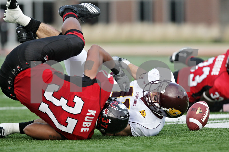 Rob Winner – rwinner@daily-chronicle.com<br /> <br /> Northern Illinois linebacker Alex Kube forces a fumble after a reception by Central Michigan receiver Cody Wilson during the first quarter in DeKalb, Ill. on Saturday October 23, 2010. DeKalb went on to defeat Central Michigan, 33-7.