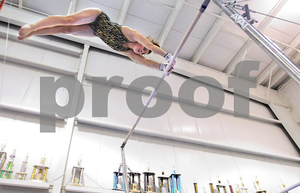 Kyle Bursaw – kbursaw@daily-chronicle.com<br /> <br /> Jessica Morreale, a senior on the DeKalb gymnastics team, practices a routine on the uneven bars at Energym in Sycamore, Ill. on Tuesday, Dec. 21, 2010.