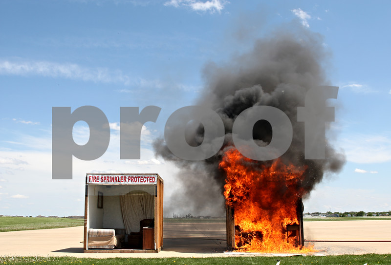 Beck Diefenbach  -  bdiefenbach@daily-chronicle.com<br /> <br /> An single room without a sprinkler system in engulfed in flames less than three minutes from ignition during a demonstration by the DeKalb Fire Department in support of sprinkler systems at DeKalb Taylor Municipal Airport in DeKalb, Ill., on Monday May 3, 2010. The room on the left was later ignited and extinguished with its sprinkler system.