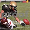 Kyle Bursaw - kbursaw@daily-chronicle.com<br /> <br /> Sycamore's Trent Greer dives for a loose ball in the second quarter in in Sycamore, Ill. on Nov. 6, 2010. The Montini Broncos defeated the Sycamore Spartans 28-7.
