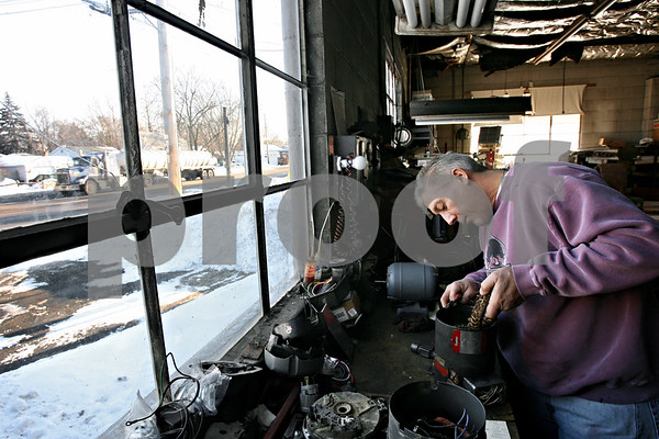 Rob Winner – rwinner@daily-chronicle.com<br /> Paul Erker, of GEM Electric Motor Repair in DeKalb, Ill., repairs a motor on Wednesday January 13, 2010. GEM, which has been a family owned business for 45 years, is located at 1400 E. Lincoln Hwy.