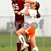 Beck Diefenbach  -  bdiefenbach@daily-chronicle.com<br /> <br /> DeKalb's Alli Smith (9, right) collides with Plainfield North's Carlie Corrigan (25) during the second half of the game at DeKalb High School in DeKalb, Ill., on Monday April 12, 2010. Plainfield North defeated Dekalb 4 to 1.