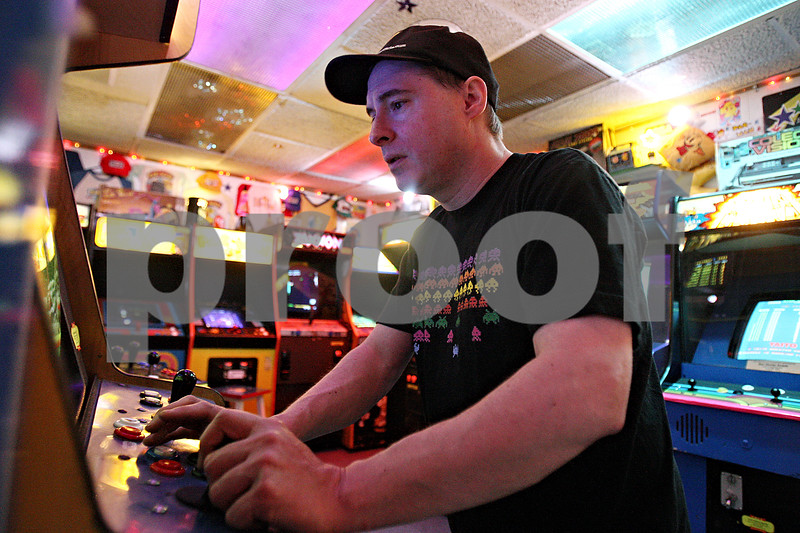Rob Winner – rwinner@daily-chronicle.com<br /> Pat O'Malley, owner of Star Worlds in DeKalb, Ill., plays one of his numerous arcade games on Friday January 22, 2010. Star Worlds is celebrating its 25th anniversary.