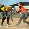 Beck Diefenbach  -  bdiefenbach@daily-chronicle.com<br /> <br /> Sycamore's Ashley Colen (6, left) is safe at third base as DeKalb's Danielle Thibault (6) can't make the tag during the third inning of the IHSA Class 2A Regional semi final game at Sycamore High School in Sycamore, Ill., on May 27, 2010.