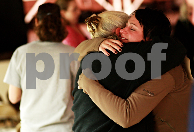 Beck Diefenbach – bdiefenbach@daily-chronicle.com<br /> <br /> Sarah Banbury (right) is embraced after speaking about her experience of being assaulted by her husband during Safe Passage's annual candle light vigil at the DeKalb Area Women's Center in DeKalb, Ill., on Monday Oct. 4, 2010.