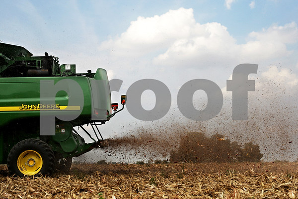 Beck Diefenbach – bdiefenbach@daily-chronicle.com<br /> <br /> Remnants of corn stalks are sprayed out the back of a combine operated by Paul Rasmussen in Sycamore, Ill., on Tuesday Sept. 21, 2010.
