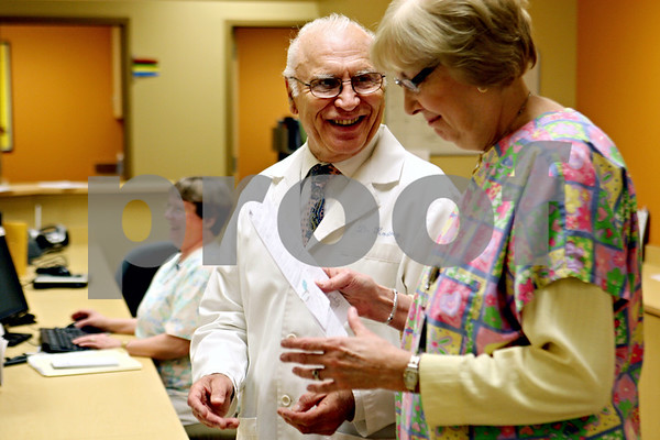 Rob Winner – rwinner@daily-chronicle.com<br /> <br /> Spotlight on Dr. John M. Kostrey<br /> <br /> *looking over paperwork with Mary Stivers