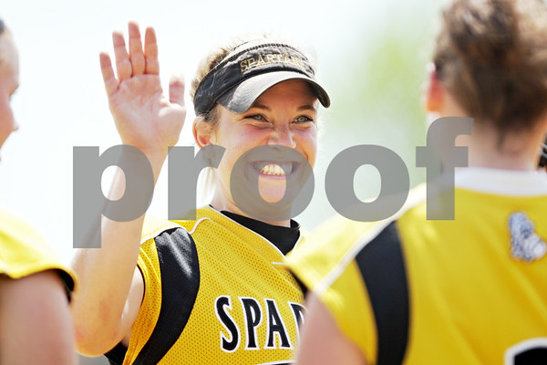 Rob Winner – rwinner@daily-chronicle.com<br /> <br /> Sycamore's Kelcee Miller is greeted by her teammates after catching a fly ball to end the third inning of the IHSA Class 3A Sycamore Regional championship game on Saturday May 29, 2010 in Sycamore, Ill. Sycamore went on to defeat Kaneland, 6-3.
