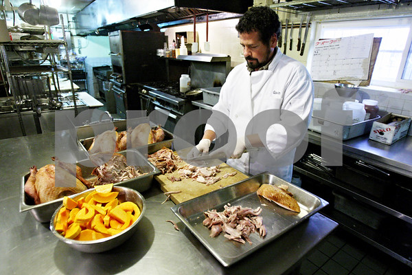 Rob Winner – rwinner@daily-chronicle.com<br /> <br /> On Monday, owner and executive chef Gavin Wilson, of the Hillside Restaurant in downtown DeKalb, prepares turkey dinners for pickup before the holiday.