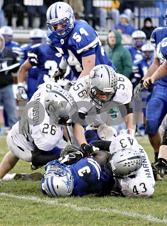 Wendy Kemp - For The Chronicle<br /> <br /> Kaneland defenders smother Vernon Hills' DeVaris Daniels during Saturday's playoff game at Vernon Hills High School.