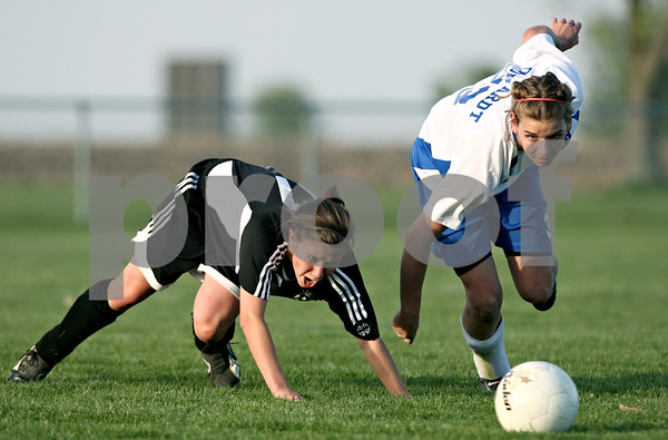 Rob Winner – rwinner@daily-chronicle.com<br /> <br /> Kaneland's Andie Bruce (left) and Hinckley-Big Rock's Tess Godhardt chase continue play before a whistle blew for a tripping penalty on Godhardt during the first half of their game in Hinckley, Ill. on Wednesday April 28, 2010.
