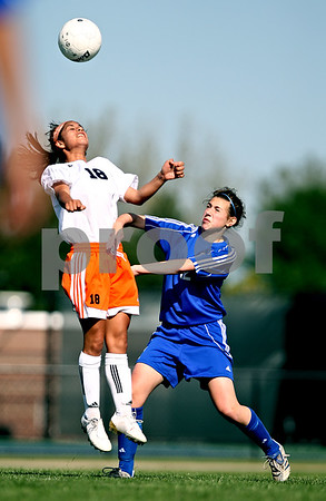 Beck Diefenbach  -  bdiefenbach@daily-chronicle.com<br /> <br /> DeKalb's Lizzy Conejo (18) leaps to head the ball over Burlington Central's Catherine Kaynish (12) during the first half of the game at Rochelle Township High School in Rochelle, Ill., on Tuesday May 18, 2010. DeKalb defeated Burlington Central 4 to 2.