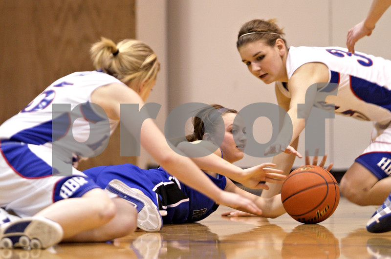 Beck Diefenbach  -  bdiefenbach@daily-chronicle.com<br /> <br /> Newark's Katie Larson (12, left) and Hinckley-Big Rock's Tess Godhardt (33)reach for a loose ball during the first quarter of the game at H-BR High School in Hinckley, Ill., on Thursday Jan. 14, 2010. H-BR defeated Newark 46 to 30.