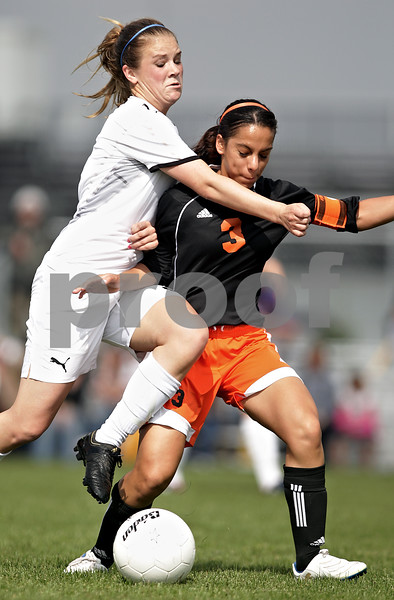 Beck Diefenbach  -  bdiefenbach@daily-chronicle.com<br /> <br /> Sycamore Krista Koeplin (5, left) and DeKalb Jassmine Marquez (3) fight for the ball during the first half of the IHSA Class 2A Rochelle Regional Championship at Rochelle Township High School in Rochelle, Ill., on Friday May 21, 2010. Sycamore defeated DeKalb 2 to 1.