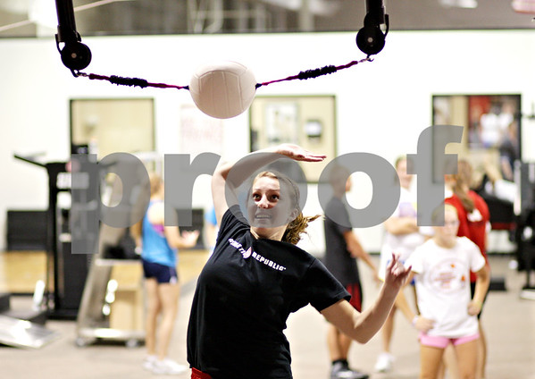 Beck Diefenbach  -  bdiefenbach@daily-chronicle.com<br /> <br /> Meredith Ament, of Maple Park, spikes a stationary volleyball during training at Athletic Republic in DeKalb, Ill., on Wednesday July 21, 2010.