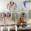 Beck Diefenbach  -  bdiefenbach@daily-chronicle.com<br /> <br /> Kristina Mathey moves clothing to the front of her consignment shop, Second Time Around, in Sycamore, Ill., on Monday July 19, 2010. After a year in business, the store is closing July 23.