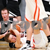Beck Diefenbach - bdiefenbach@daily-chronicle.com<br /> <br /> Kaneland's Steve Colombe (21, top) tries to tear the ball from DeKalb Chris Calbow (10) during the third quarter of the IHSA Class 3A Regional championship game at Kaneland High School in Maple Park, Ill., on Friday March 3, 2010.