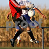 Rob Winner - rwinner@daily-chronicle.com<br /> <br /> Kaneland goalkeeper J.P. Minogue tries to control a ball as Hinckley-Big Rock's Lee Klein tries to make a play during the first half of their game in Hinckley, Ill. on Wednesday September 8, 2010.