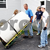 Rob Winner – rwinner@daily-chronicle.com<br /> <br /> Vaughn Boehne helps a group of youths from United Church of Christ in Shabbona, Ill. remove a water heater from a home on Friday June 11, 2010. Boehne has three children who have been collecting metals for recycling to help fund church camp for this summer.