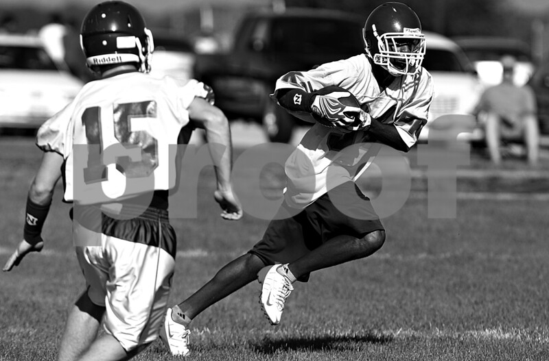 Rob Winner – rwinner@daily-chronicle.com<br /> <br /> Gabe Williams carries the ball during the Cogs' morning practice on Thursday August 12, 2010 in Genoa, Ill.