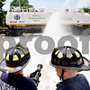 Rob Winner – rwinner@daily-chronicle.com<br /> <br /> DeKalb firefighter paramedic Tom Conley (left) and Lt. Tony Cox use a spray foam to extinguish a simulated chemical fire around a railroad tank car on Wednesday July 14, 2010 in DeKalb, Ill. The DeKalb Fire Department in cooperation with BNSF Railway and Union Pacific Railroad are hosting a first responder class this week.<br /> 07/15/2009