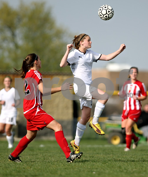 Rob Winner – rwinner@daily-chronicle.com<br /> <br /> Sycamore's Katelyn Brown goes up for a ball during the first half on Thursday April 22, 2010 in Sycamore, Ill. Batavia went on to defeat Sycamore, 2-0.