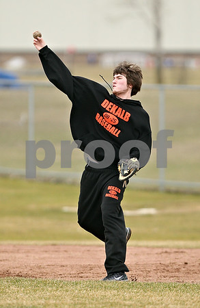 Beck Diefenbach  -  bdiefenbach@daily-chronicle.com<br /> <br /> DeKalb's Jake Jouris throws the ball from first base during practice at DeKalb High School in DeKalb, Ill., on Monday March 15, 2010.