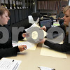 Wendy Kemp - For The Daily Chronicle<br /> Julie Nollkamper, a Deputy County Clerk (right) helps NIU student Kristen Edwards register to vote at the NIU Holmes Student Center on Monday.<br /> DeKalb 10/18/10