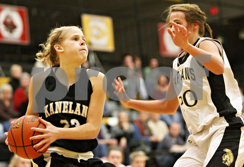 Rob Winner – rwinner@daily-chronicle.com<br /> <br /> Kaneland guard Tesa Alderman (left) is pressured by Sycamore's Ashley Berlinski during the first quarter on Friday December 10, 2010 in Sycamore, Ill.