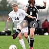 Beck Diefenbach  -  bdiefenbach@daily-chronicle.com<br /> <br /> Kaneland's Emily Heimerdinger (24, left) battles Indian Creek's Lindsay Craig (8) for the ball during the first half of the game at Kaneland High School in Maple Park, Ill., on Wednesday April 7, 2010. Kaneland defeated Indian Creek 7 to 0.