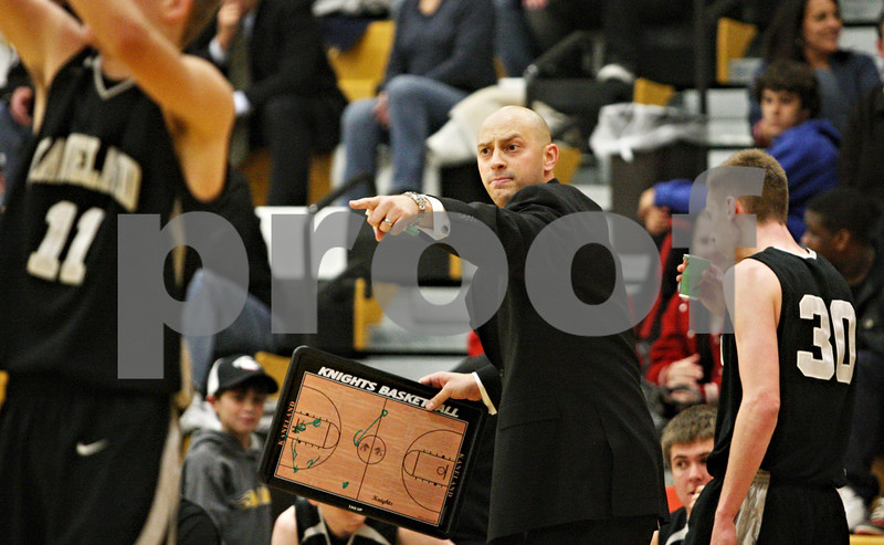 Rob Winner – rwinner@daily-chronicle.com<br /> <br /> Kaneland coach Brian Johnson tries to call a play in the final minutes Tuesday night's game in Sycamore on Tuesday night. Hope went on to defeat Kaneland, 58-48.