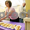 Rob Winner – rwinner@daily-chronicle.com<br /> <br /> Amber Hiland and Chris Zank prepare for a hot dog luncheon at the DeKalb County Government Legislative Center in Sycamore, Ill. on Wednesday May 26, 2010, to raise money for Relay for Life.