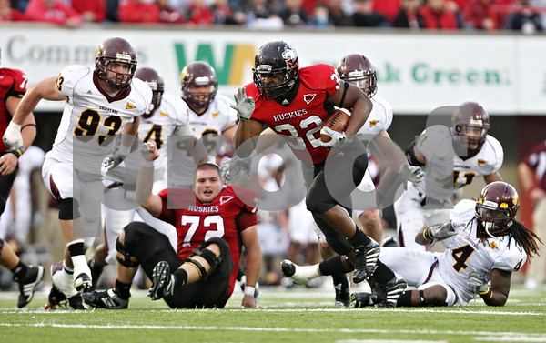 Rob Winner – rwinner@daily-chronicle.com<br /> <br /> Northern Illinois running back Cameron Bell carries the ball during the third quarter in DeKalb, Ill. on Saturday October 23, 2010. DeKalb went on to defeat Central Michigan, 33-7.