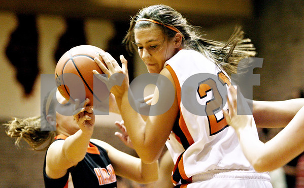 Rob Winner – rwinner@daily-chronicle.com<br /> <br /> DeKalb's Kelli Gerace tries to control a ball underneath the Barbs' basket in the first quarter on Tuesday November 16, 2010 in DeKalb, Ill.