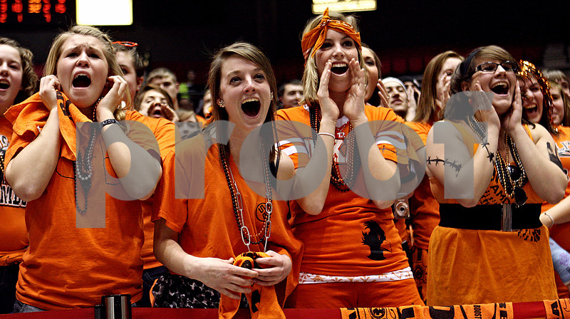 Rob Winner – rwinner@daily-chronicle.com<br /> DeKalb fans including Cara Sisler (from left to right), Allison Anderson,  Brooke Howes and Margaret Clucas scream while Lake Kwaza prepares to take her second free throw shot which eventually would help give the Sycamore girls basketball team a win over DeKalb during the Castle Challenge on Friday January 29, 2010.