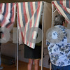 Kyle Bursaw - kbursaw@daily-chronicle.com<br /> <br /> Voters enter the voting booths at Hopkins Park Terrace Room in DeKalb, on Nov. 2, 2010.