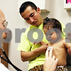 Rob Winner – rwinner@daily-chronicle.com<br /> <br /> Community Cares Clinic physician assistant David Wester examines 1-year-old Jennifer Garcia as her father Melencio Garcia holds her on Friday October 22, 2010 in DeKalb, Ill.