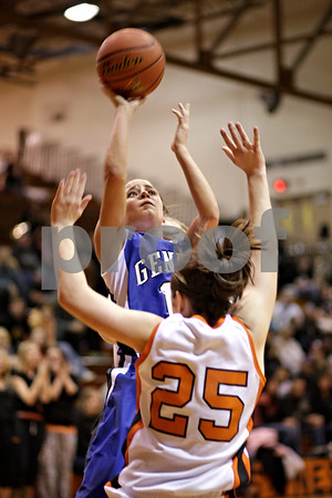 Beck Diefenbach  -  bdiefenbach@daily-chronicle.com<br /> <br /> Geneva's Kate Yelle (14, top) shoots the ball over DeKalb's Shelby Wood (25) during the second quarter of the game at DeKalb High School, in DeKalb, Ill., on Friday Jan. 5, 2010. Geneva defeated DeKalb 44 to 41.
