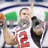 Kyle Bursaw – kbursaw@daily-chronicle.com<br /> <br /> Northern Illinois quarterback Chandler Harnish (12) warms up his throwing arm before the MAC championship game<br /> between the Northern Illinois Huskies game and the Miami (Ohio) Redhawks<br /> at Ford Field in Detroit, Mich. on Friday, Dec. 3, 2010